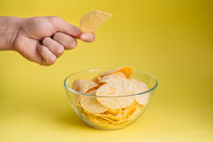 Plate of chips unhealthy food. On blue color background Stock Photo