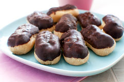 Plate of chocolate coated eclairs Royalty Free Stock Photo
