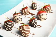 Plate with chocolate covered strawberries stock images