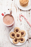 Plate of chocolate peanut blossom cookies and hot chocolate Stock Photos