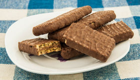 Plate with chocolate wafers on table. Stock Image