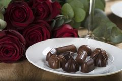 Chocolates with Red Roses Stock Photo