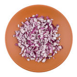 Plate of chopped red onion on white background. Stock Image