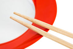 Plate and chopsticks Stock Photography