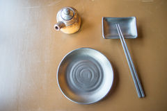 Plate and chopsticks Royalty Free Stock Photo