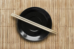 Plate and chopsticks Royalty Free Stock Photography
