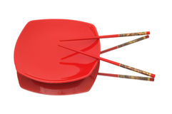 Plate and chopsticks isolated  hite background Royalty Free Stock Photo