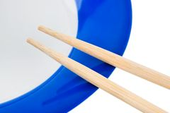 Plate and chopsticks Royalty Free Stock Image