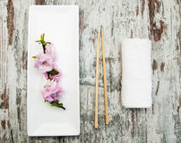 Plate, chopsticks and sakura branch Royalty Free Stock Photos