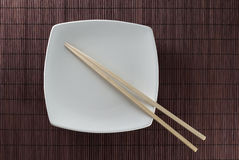 Plate with chopsticks Stock Photography