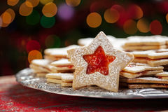 Plate of Christmas cookies under lights stock image