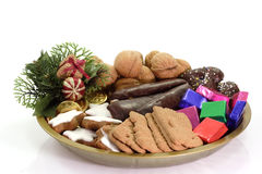 Plate of Christmas Goodies. Plate of different christmas goodies on bright background stock image
