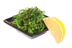 Plate with chuka salad and lemon Stock Images