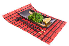 Plate with chuka salad on a red mat Stock Photography