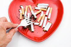 Plate with cigarette Royalty Free Stock Photos
