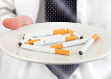 Plate With Cigarettes Royalty Free Stock Photo