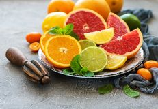 Citrus fresh fruits. Plate with citrus fresh fruits on a concrete background stock photo
