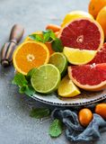 Citrus fresh fruits. Plate with citrus fresh fruits on a concrete background stock photography