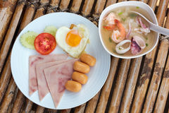 Plate with classic breakfast on a bamboo table Stock Images