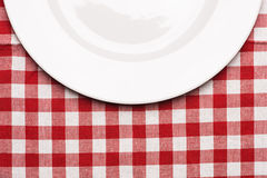 Plate at classic checkered tablecloth Royalty Free Stock Photo