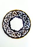 Plate with classic ornament stylized uzbek Cotton on the edge is Golden stripe Stock Photography