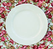 Plate at classic tablecloth. Royalty Free Stock Photos