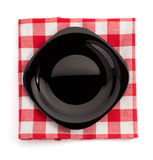 Plate at cloth napkin on white. Background Royalty Free Stock Images