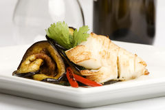 Plate of Cod with side of eggplant and peppers Stock Photos