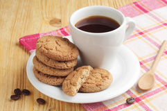 Plate with coffee and oatmeal cookies Royalty Free Stock Images