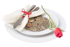 Plate with coins knife and fork Stock Photography