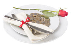 Plate with coins knife and fork Royalty Free Stock Images