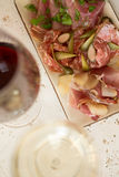 Plate of Cold Cuts and Glasses of Wine Royalty Free Stock Photos