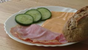Plate of cold ham and cheese stock video footage