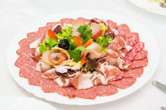 Plate of cold meats in the restaurant. Meat snacks. Smoked sausage and bacon, Stock Photos