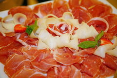 Plate of cold meats in the restaurant. Meat snacks. Smoked sausage and bacon, Royalty Free Stock Photos