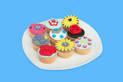 A plate with colorful cup-cakes Royalty Free Stock Photo