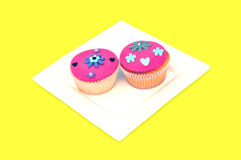 Plate with colorful cup-cakes Stock Images