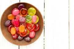 A plate with colorful lollipops. White background. Royalty Free Stock Images