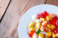 Plate with colorful sweet candies Royalty Free Stock Photo