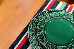 Plate and colorful table cloth Stock Photos