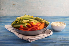 Plate of colorful vegetable sticks with dip sauce Stock Photo