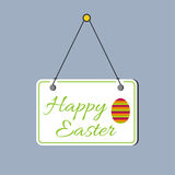Plate with congratulations. Hanging on the door. Happy Easter. Easter Egg Royalty Free Stock Image