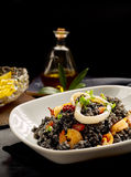Plate of cooked arroz negro with oil in background Royalty Free Stock Images