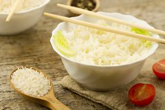 Plate of cooked long-grain rice on wooden background. Healthy eating, diet, vegetarianism. Stock Photo