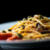 Plate of cooked savory Italian spaghetti Royalty Free Stock Images