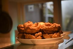 Delicious golden Yorkshire puddings for a roast dinner stock images