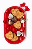 Plate with cookies and candies for St. Valentine`s Day, top view stock images