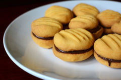 Plate of cookies with chocolate hazelnut filling Stock Photos