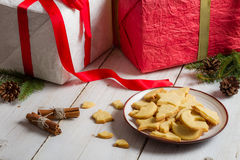 Plate with cookies and Christmas gifts Royalty Free Stock Images