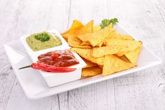 Tortilla chip and sauce Stock Images